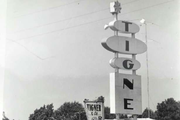The front view in 1965 of Tigner & Co Realtors along Hi-Y's highway 75 frontage. Tigner was awell-known Realtor in Conroe having key roles in local and state real estates locations. He operated Tigner & Company Realtors on South Frazier. According to a 1966 article from The Courier, his company was known by its hook and ladder fire engine trademark.