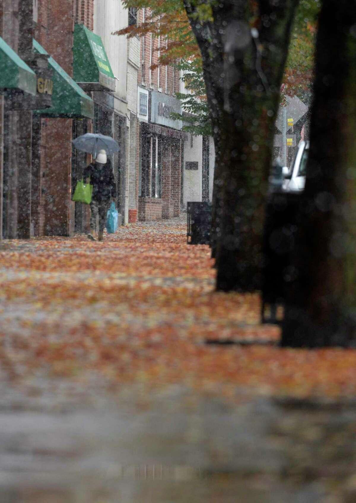 A shopper walks along Main Street on October 30, 2020, Danbury, Conn.