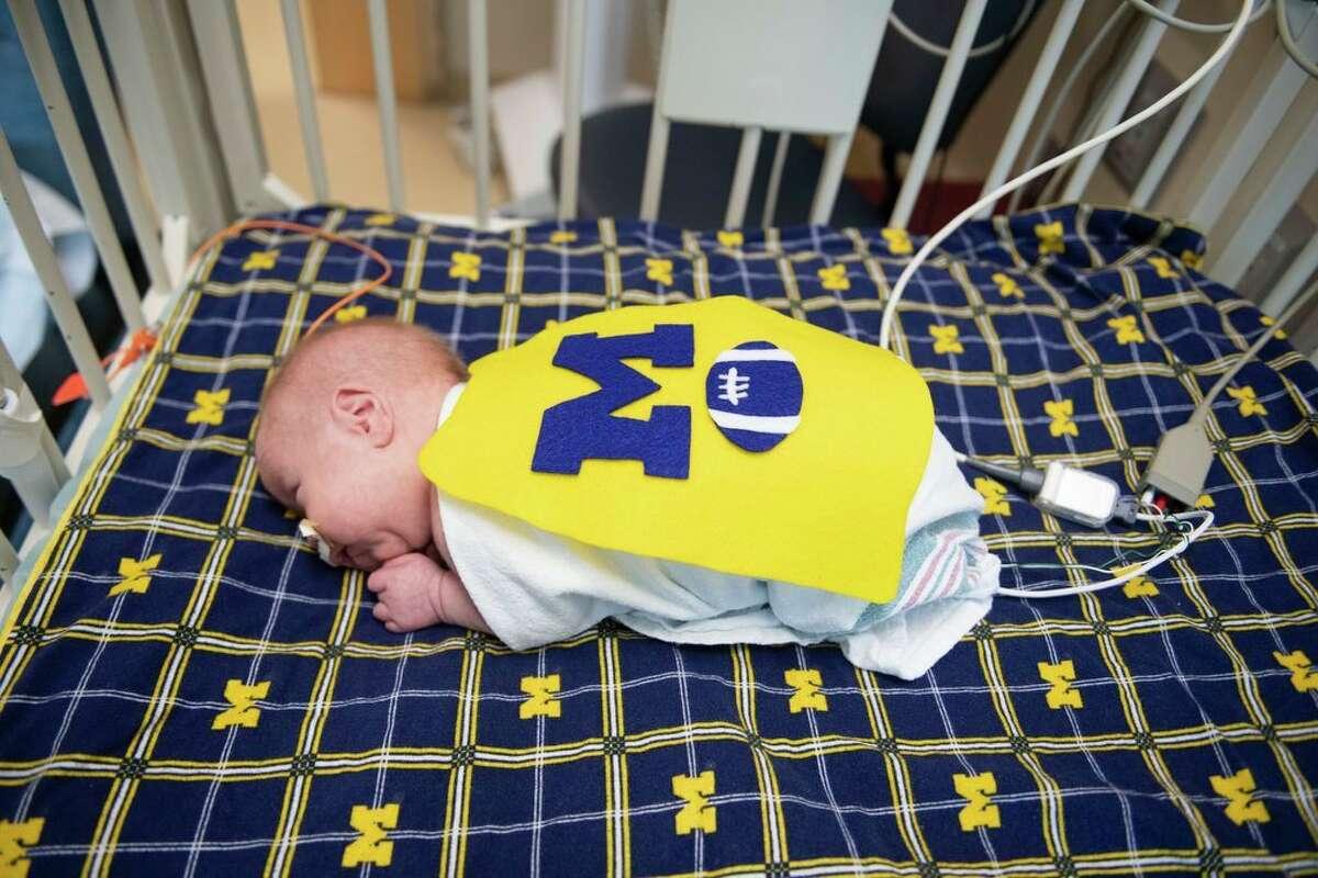 Tate Ryskamp, 17 days old, wears a University of Michigan football jersey costume. (Taylor Ballek/Spectrum Health Beat)