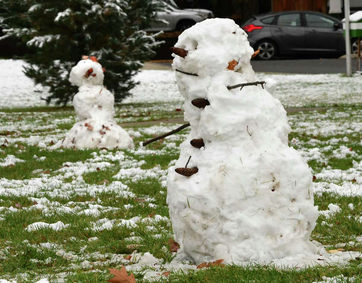 A couple of recently made snowmen are seen on the front lawn of Eagle Point Elementary School after the Capital Region received its first snow fall of the season on Friday, Oct. 30, 2020 in Albany, N.Y. (Lori Van Buren/Times Union)