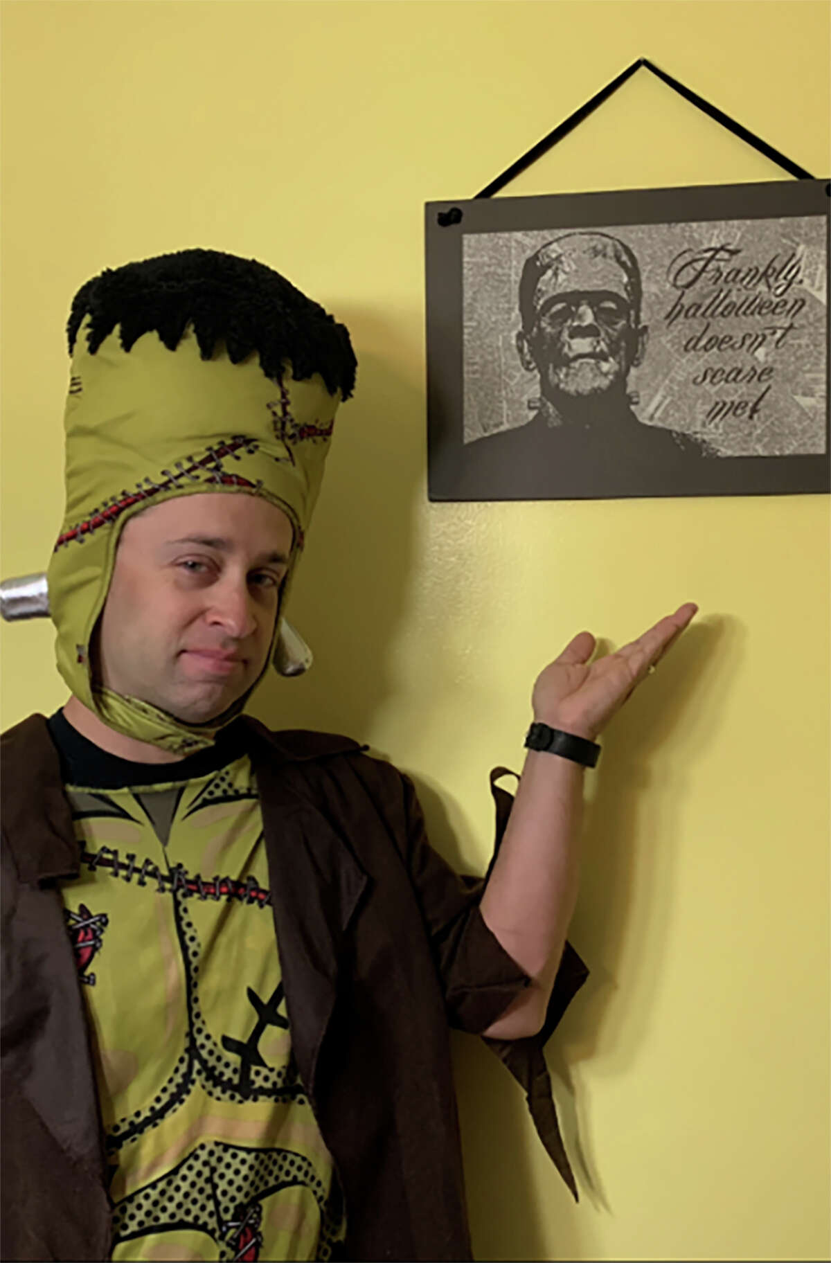 Jeff Frankenstein shows off his Frankenstein costume and his decorative Frankenstein sign at his Pennsylvania home.