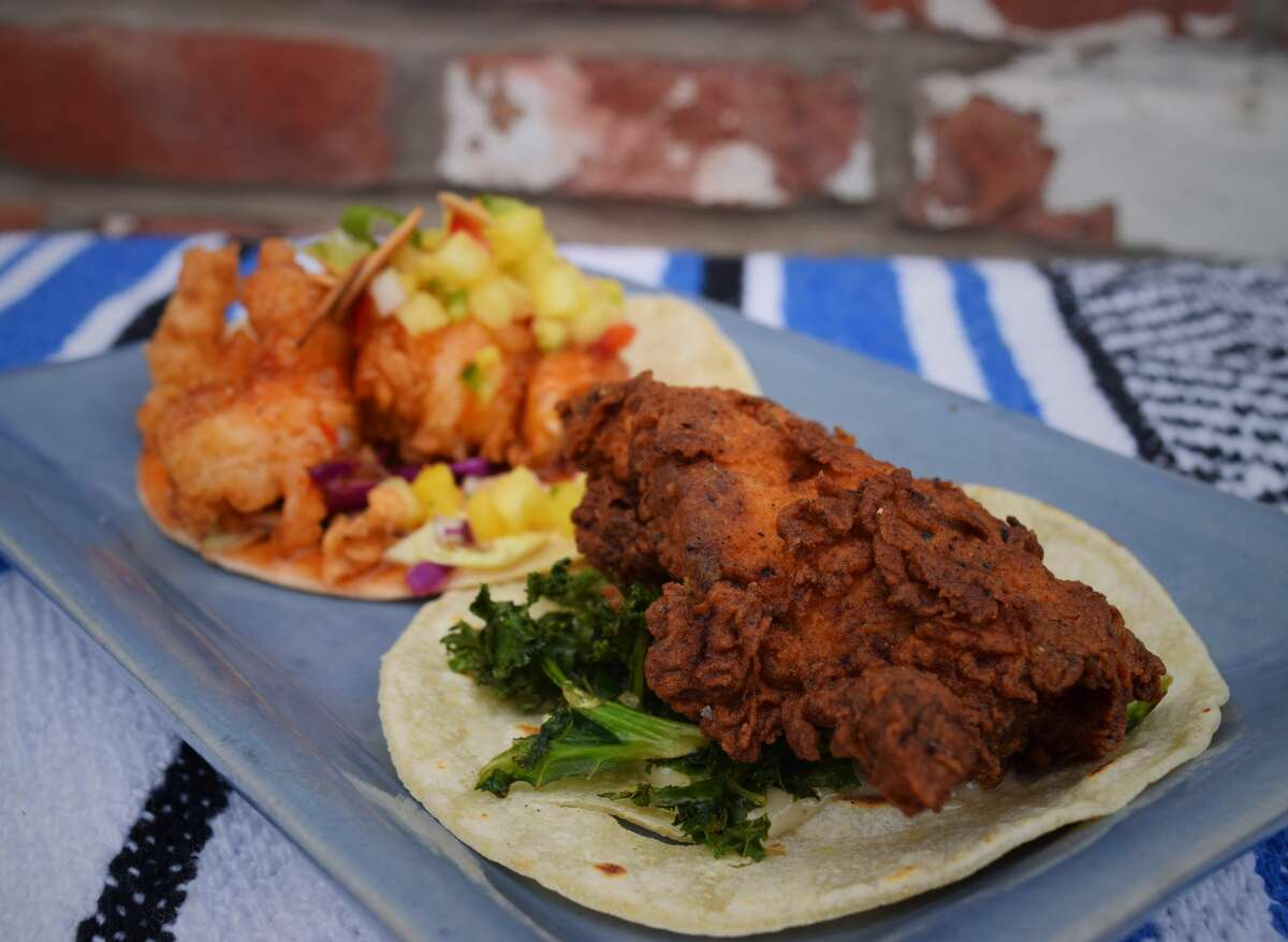 Chili shrimp and fried chicken taco from Sayulita in South Glastonbury. And if you're cruising around the state, it might be worth a trip to South Glastonbury for Sayulita's, a little blue house that is home to Mexican-inspired food that has garnered 423 reviews and 4.5 stars on Yelp (as of Oct. 30). Inspired by the food he found in Sayulita, Mexico, owner Bill Driggs recreated the culture in his restaurant. He takes traditional recipes and techniques of staples like rice and beans and puts a chef's twist on them to create dishes like buttermilk fried chicken tacos and chipotle agave ribs. The inventive dishes have a cult following. Seasonal recipes, with ingredients often sourced from local farms, are also a favorite here from strawberry margaritas in the spring to chicken and apple tacos in the fall. Check out 15 top Yelp-reviewed Mexican restaurants in Connecticut: