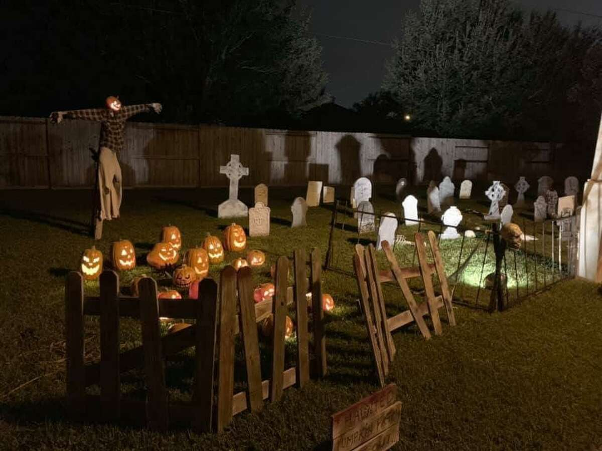 Cindy Gise, Cy-Fair resident, decorated their yard with tombstones, pumpkins and lights for Halloween.