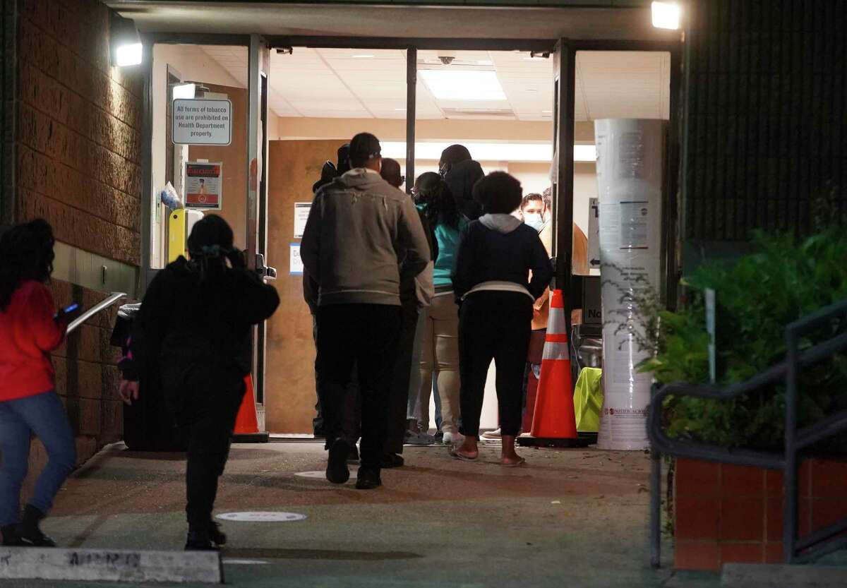 Voters enter Kashmere MultiService Center in Houston on Thursday, October 29, 2020. That location, along with seven others, was open to voters overnight Thursday.
