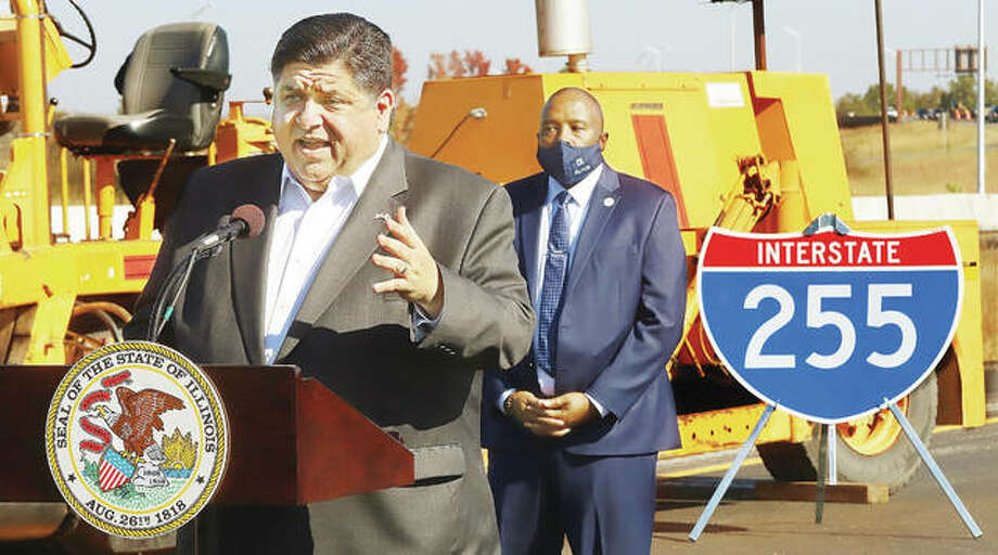 Standing on Interstate 255 south of the I-64 interchange, Gov. J.B. Pritzker on Oct. 22 congratulates construction workers on completing the $67 renovations and repaving job on the interstate south to Illinois 15 ahead of schedule. The roadway is scheduled to reopen Saturday morning; work on the project began in February.