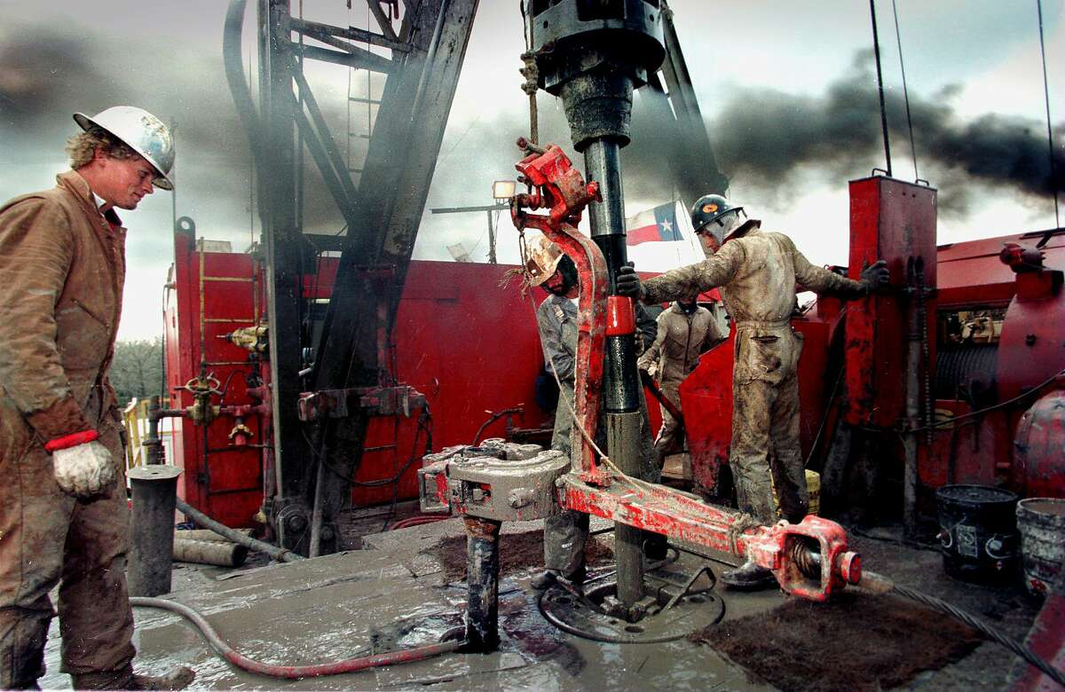 Colorado County. Roughnecks Justin Maddox , James Myers, and Billy Truitt work on the deck of rig number 4 for South Texas Drilling's natural gas project in Colorado County.