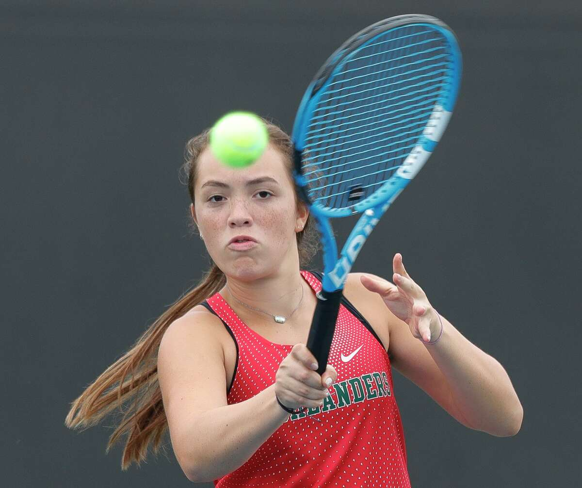 The Woodlands' Vicky Conde returns a serve competes during a high school tennis match at Grand Oaks High School, Thursday, Sept. 24, 2020, in Spring.