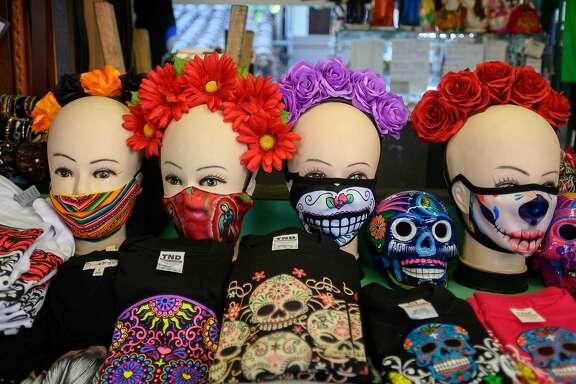 LOS ANGELES, CALIFORNIA - OCTOBER 29: Face masks are seen at the Dia De Los Meurtos shops on Olvera Street on October 29, 2020 in Los Angeles, California. (Photo by Emma McIntyre/Getty Images)
