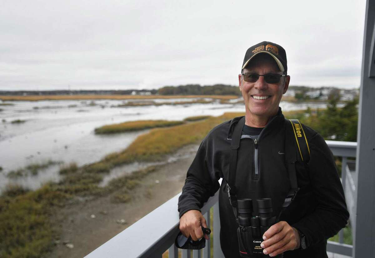 Board of Advisors member George Amato observes birds for a regular bird count at the Connecticut Audubon Coastal Center in Milford on Wednesday, October 28, 2020. The center is celebrating its' 25th anniversary.