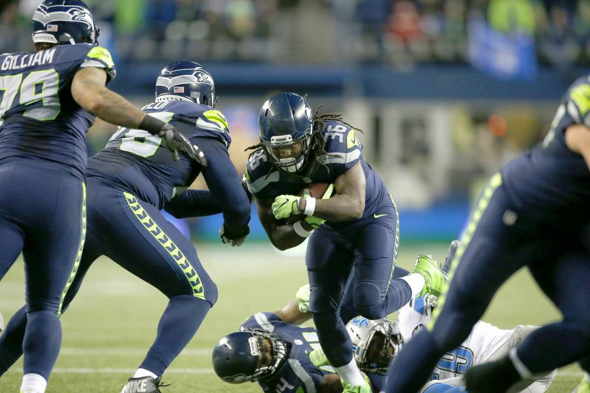 SEATTLE, WA - JANUARY 07: Running back Alex Collins #36 of the Seattle Seahawks rushes against the Detroit Lions in the NFC Wild Card game at CenturyLink Field on January 7, 2017 in Seattle, Washington. (Photo by Otto Greule Jr/Getty Images)