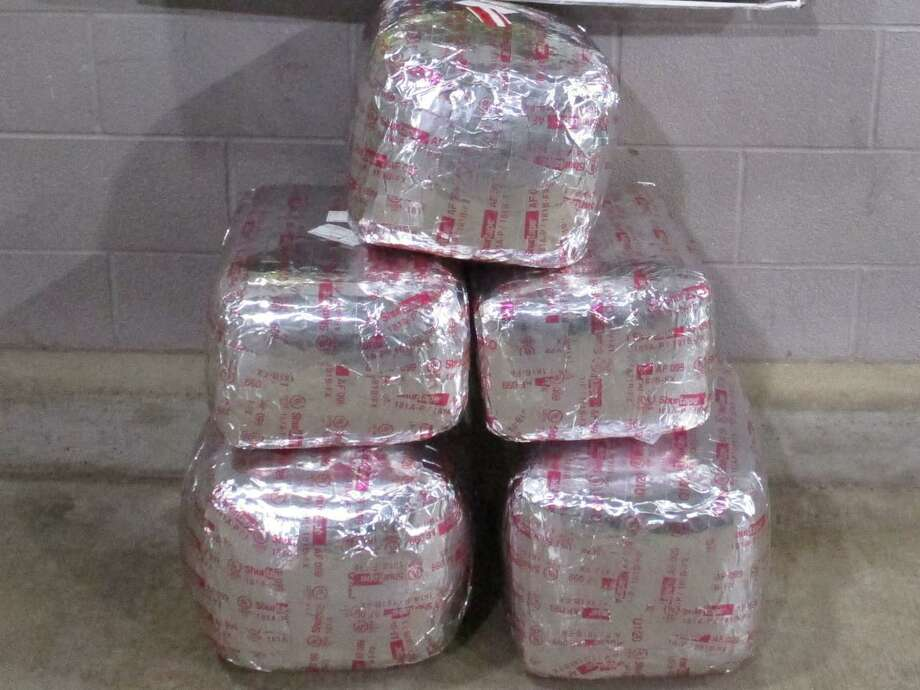 U.S. Border Patrol agents said they seized these 128.33 pounds of marijuana at the Interstate 35 checkpoint. The contraband had an estimated street value of more than $100,000. Photo: Courtesy Photo /U.S. Border Patrol