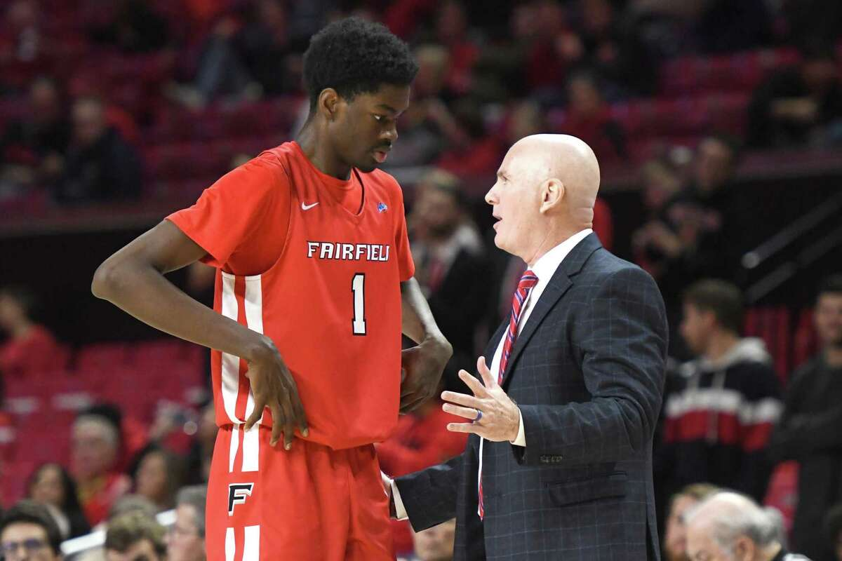 COLLEGE PARK, MD - NOVEMBER 19: Chris Maidoh #1 of the Fairfield Stags talks to head coach Jay Young during a basketball game against the Maryland Terrapins at the Xfinity Center on November 19, 2019 in College Park, Maryland. (Photo by Mitchell Layton/Getty Images)