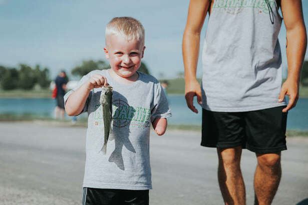 A NubAbility camper and his catch.
