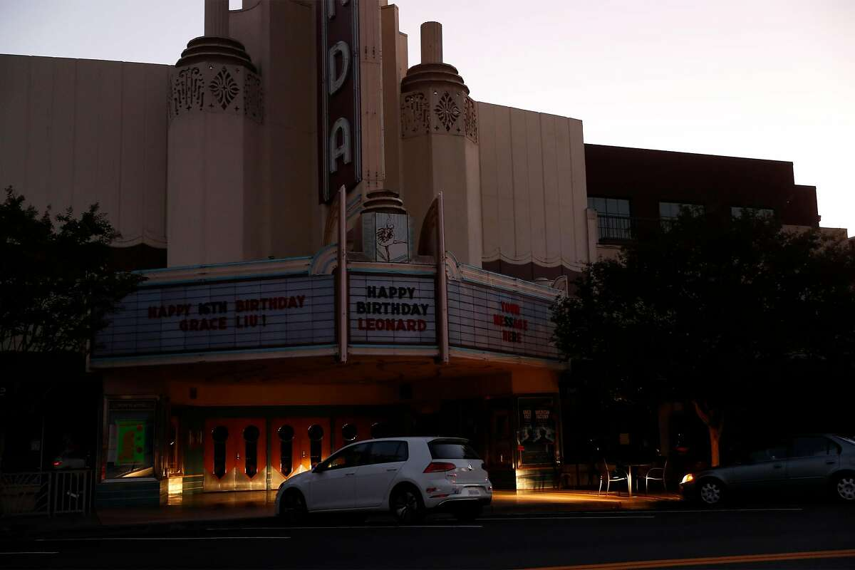 Headlights illuminate the front of Orinda Theatre on Moraga Way during a PG&E power shut-off Monday. PG&E once again powered down its lines to prevent them from sparking fires.