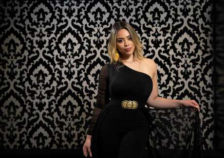 Singer Michelle Raymon poses for a photograph Friday, Oct. 2, 2020, in Houston. Raymon, from Colombia, was a contestant on La Voz, the Spanish-language version of The Voice.