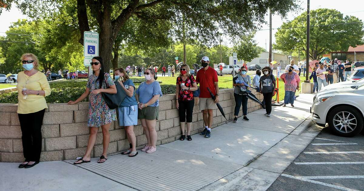 People wait in line to vote on the first day of early voting at Universal City Library on Oct. 13, 2020. This year's election has seen unprecedented in-person turnout levels, particularly in Texas.