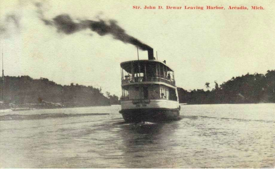 In the early 1900s the ship John D. Dewar leaves Arcadia harbor. (Courtesy Photo/Manistee County Historical Museum)