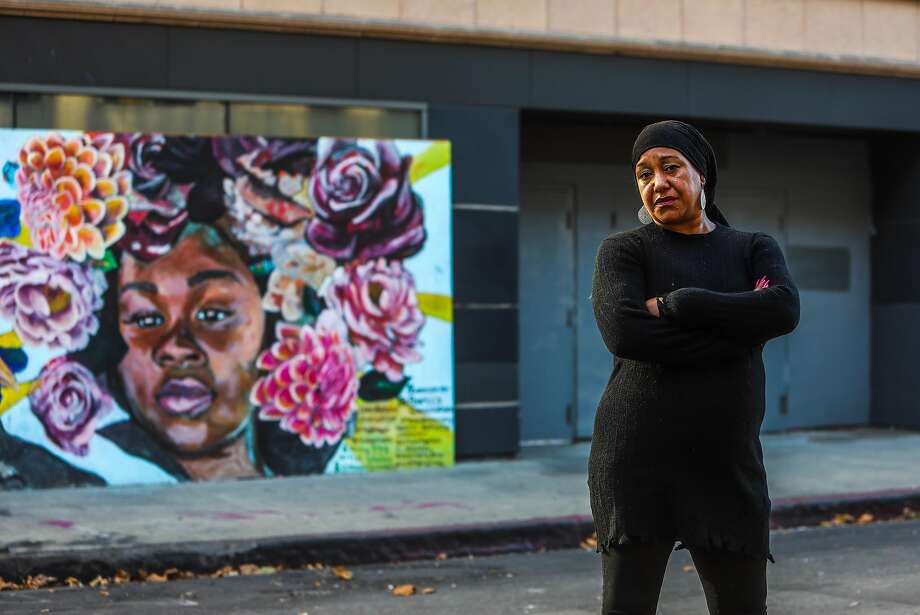 Cat Brooks, the co-founder of the Anti-Police Terror Project, in front of a Breonna Taylor mural. Photo: Yalonda M. James / The Chronicle