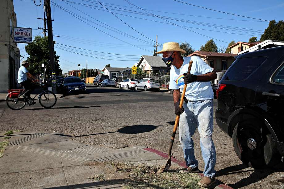 Richard Breaux participates in a neighborhood cleanup at 62nd Avenue and Hayes Street last month. Breaux and his wife, Zenobia, are also members of the Reimagining Public Safety Task Force. Photo: Photos By Yalonda M. James / The Chronicle