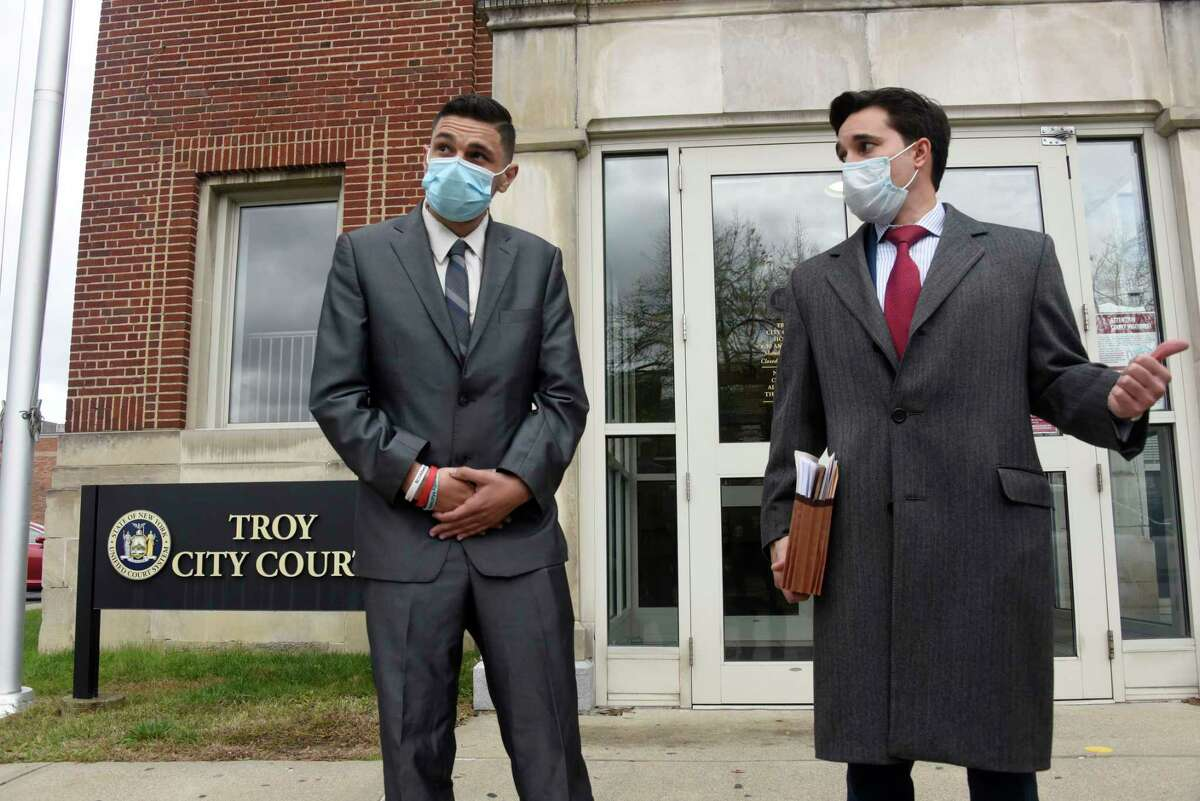 Barker Park Coalition activist Kenneth Zeoli, left, is seen outside of Troy City Court with his attorney Matthew Toporowski, right, after a hearing on Friday, Oct. 30, 2020 in Troy, N.Y. Zeoli alleges that he was pushed down stairs in the Troy police station, injuring his shoulder after attempting to file a report. (Lori Van Buren/Times Union)