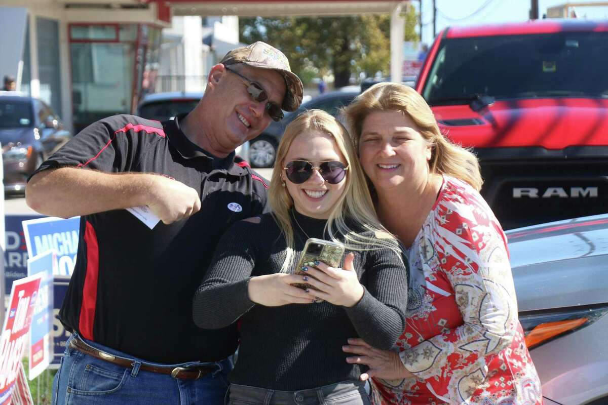 Alexa Lange stops outside the Juergens Hall Community Center Dance Hall to take a selfie with her parents Kevin and Alexa to post on her social media. It was the first time to vote for the 20-year-old.