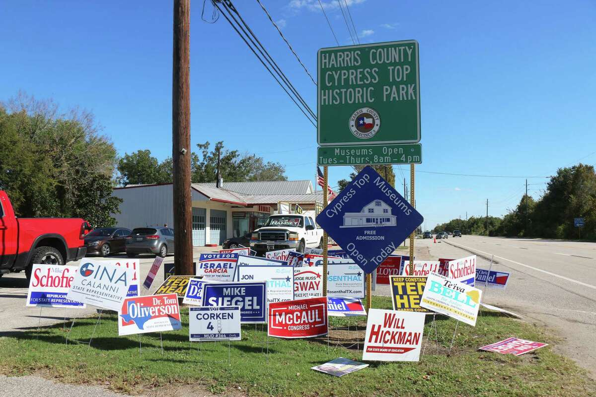 There's few patches of grass for politicians to post their political signs outside the Juergens Hall Community Center - Dance Hall on 26026 Hempstead Highway in Cypress, but they used about every small possible space to post them as a reminder to voters.