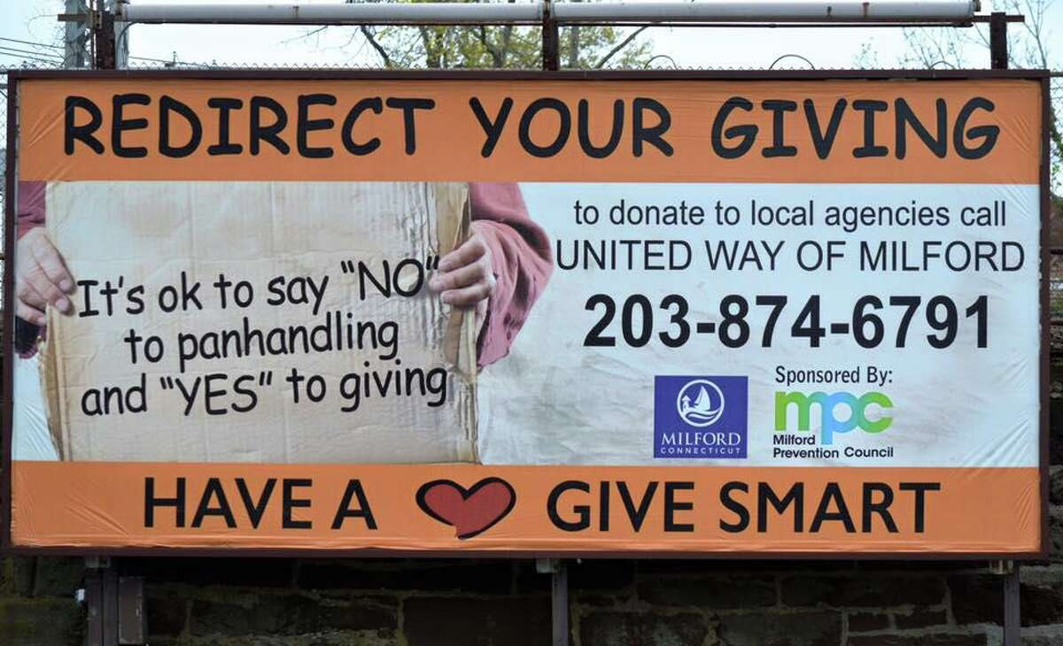 A billboard in Milford to encourage giving to charities that help the homeless