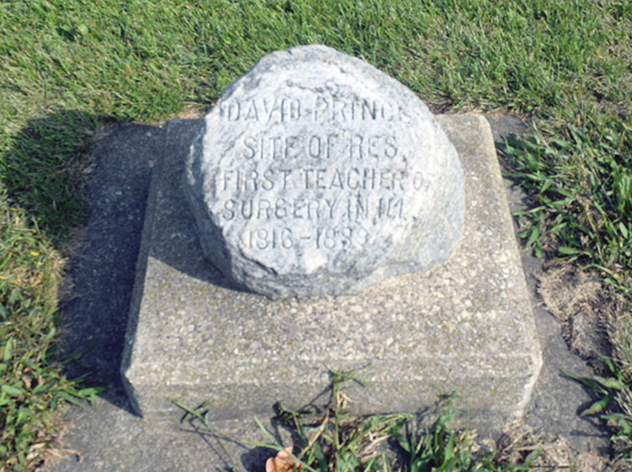A marker honoring the site of Dr. David Prince's surgery school located on North Fayette Street and West State Street. Photo: Marco Cartolano   Journal-Courier