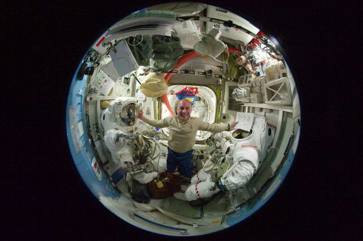 (20 May 2010) --- A fish-eye lens attached to an electronic still camera was used to capture this image of NASA astronaut Garrett Reisman, STS-132 mission specialist, in the Quest airlock of the International Space Station while space shuttle Atlantis remains docked with the station.