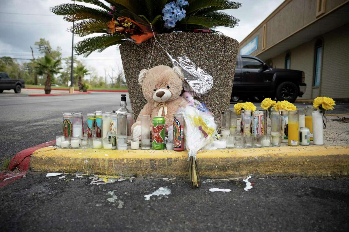 A memorial is built in front of Micheladas El Patio #2, Thursday, Oct. 15, 2020, in Conroe. Both Julio Cardenas and Jorge Galeas were killed at the location only 2 days apart.
