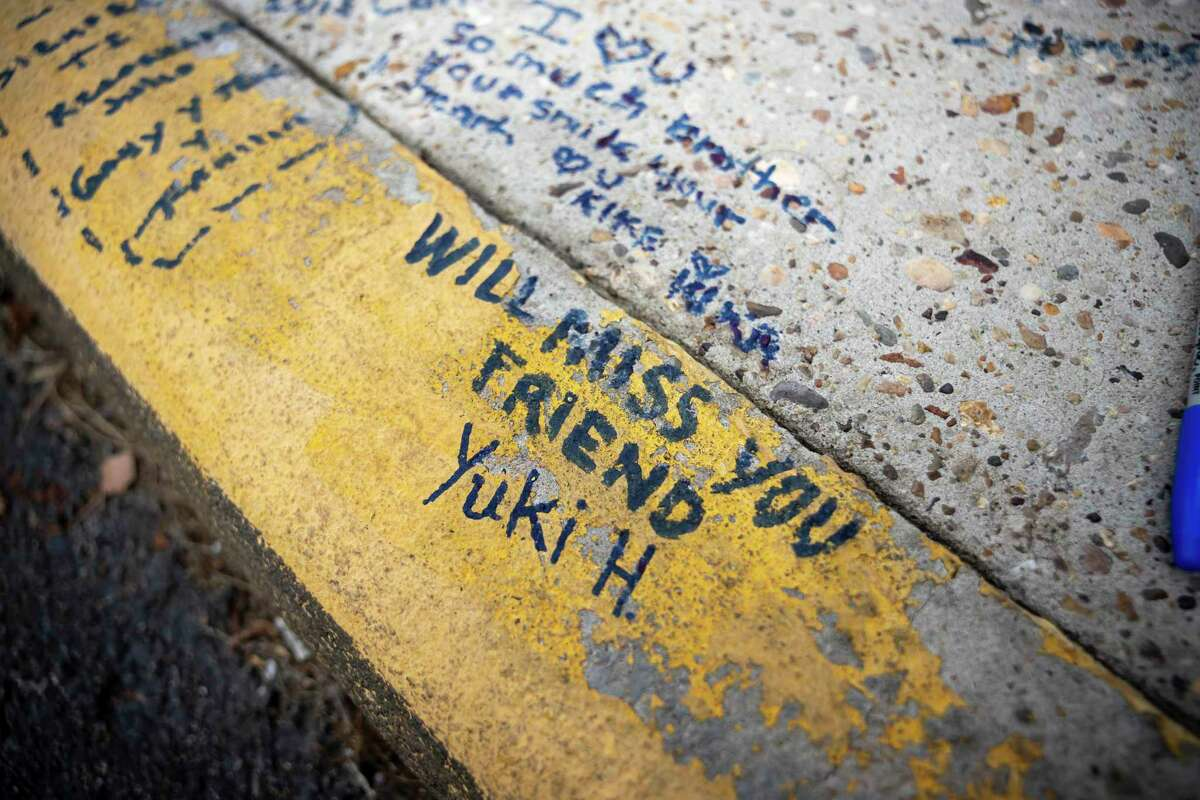 Messages to the victims are written on concrete at a memorial made in front of Micheladas El Patio #2, Thursday, Oct. 15, 2020, in Conroe. Julio Cardenas and Jorge Galeas were killed at the location only 2 days apart.