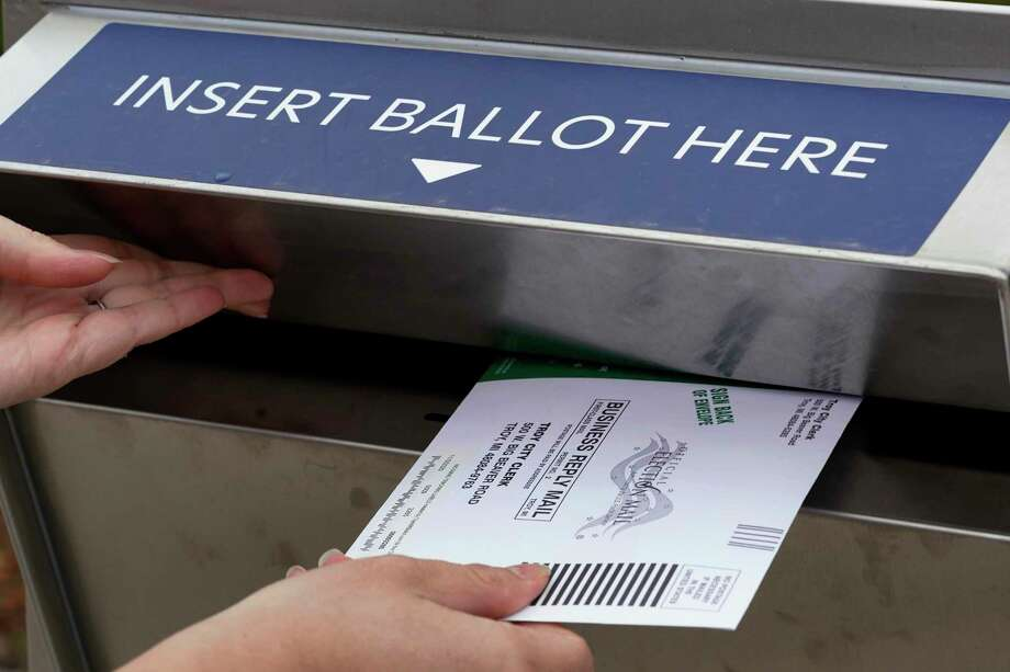A Darien resident said his absentee ballot was mistakenly filled out by a woman in his neighborhood and returned to the town clerk's office. Photo: Paul Sancya / Associated Press / Copyright 2020 The Associated Press. All rights reserved