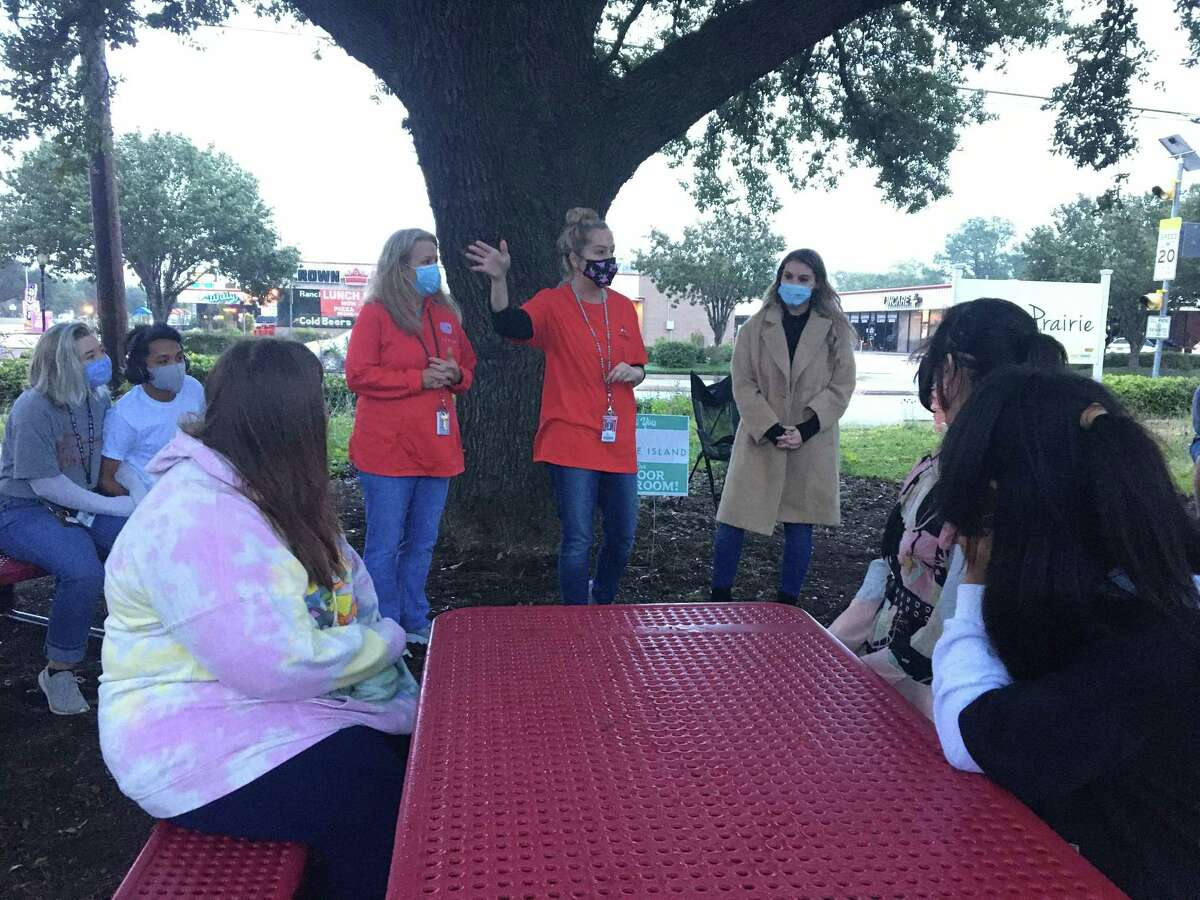 The Tiger Prairie at Katy High School now has tables and benches that provide seating for up to 32 students. The outdoor classroom space was donated by the Cane Island community of homes. Here, a science class helps teachers accept the furniture on Wednesday, Oct. 28.