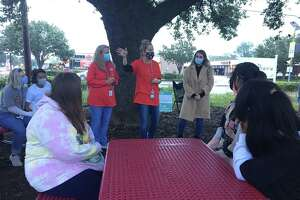 The Tiger Prairie at Katy High School now has tables and benches that provide seating for up to 32 students. The outdoor classroom was donated by the Cane Island community of homes. Here, a science class helps teachers accept the furniture on Wednesday, Oct. 28, 2020.