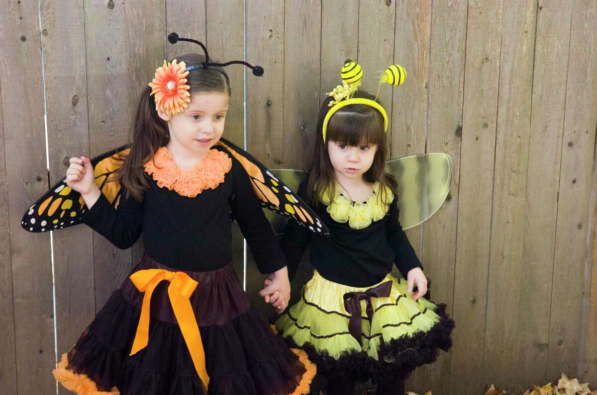 Madison and Morgan Gold display their Halloween wears at the Stamford Museum & Nature Center on Sunday, October 17, 2010. Children and their guardians can find answers to the hunt in multiple spaces throughout the Bruce, in order to keep people spaced out. The pandemic prompted staff to brainstorm some remote activities for the Halloween kits, in order to minimize the amount of time people spend inside the Bruce.