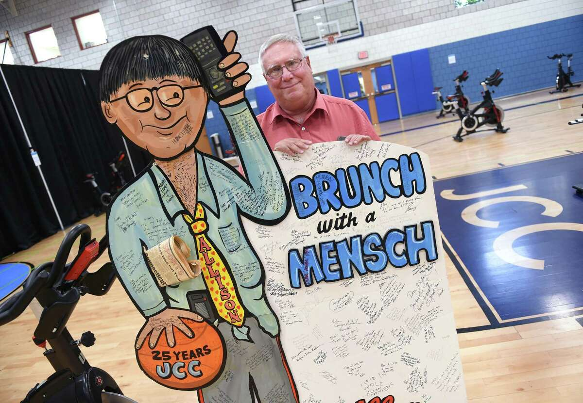 Allan Greenberg is photographed in the gymnasium at the Jewish Community Center of Greater New Haven on Oct. 28, 2020, with a memento from a 25th anniversary brunch in his honor. Greenberg is currently furloughed after working at the JCC for nearly 50 years.