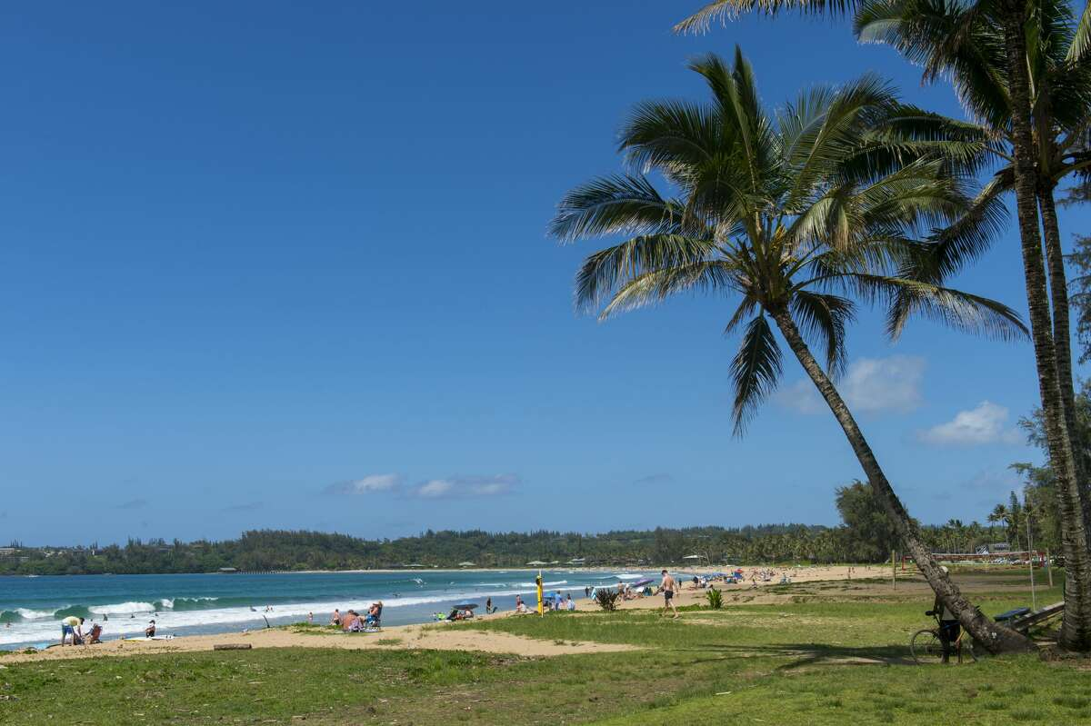 Many Hawaiian residents harbor concerns about reopening the islands to tourism even as the state depends on it economically. A view of Hanalei beach on the northern end of the Hawaiian island of Kauai, Hawaii, USA.