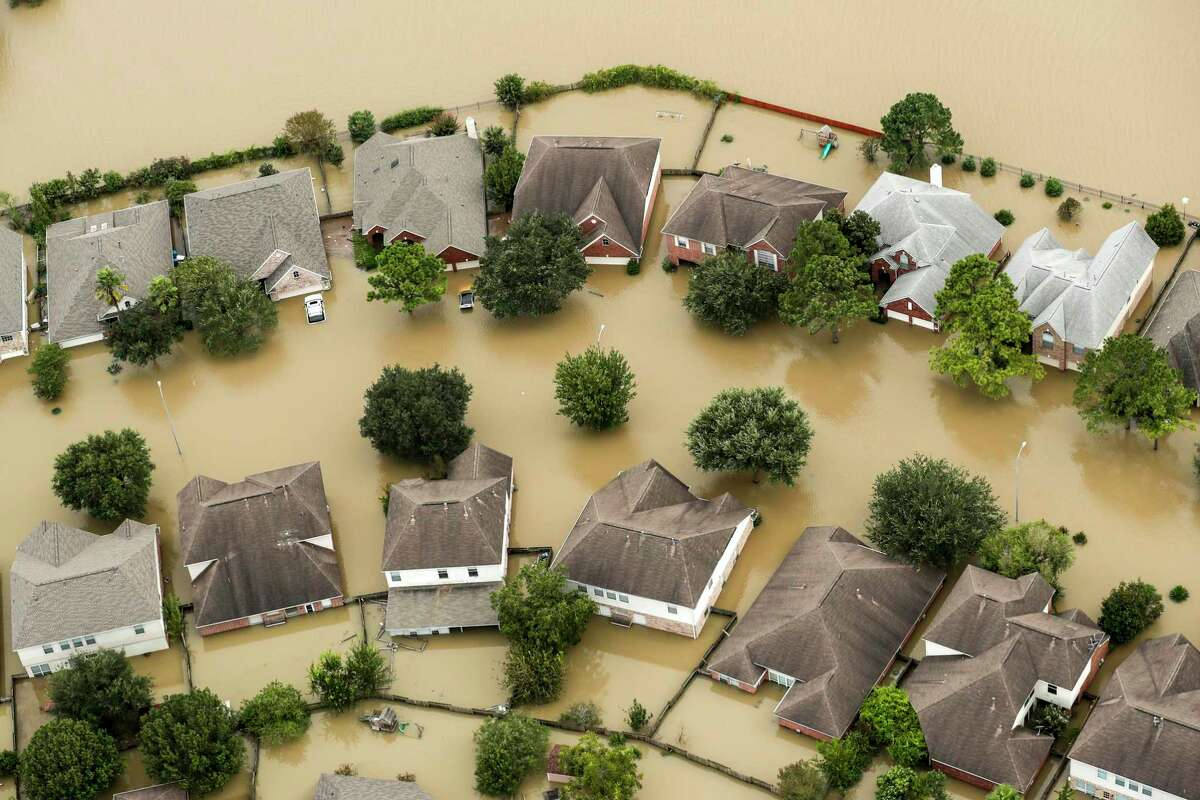 Floodwaters from the Addicks Reservoir inundated a neighborhood off N. Eldridge Parkway in the aftermath of Tropical Storm Harvey on Wednesday, Aug. 30, 2017, in Houston.