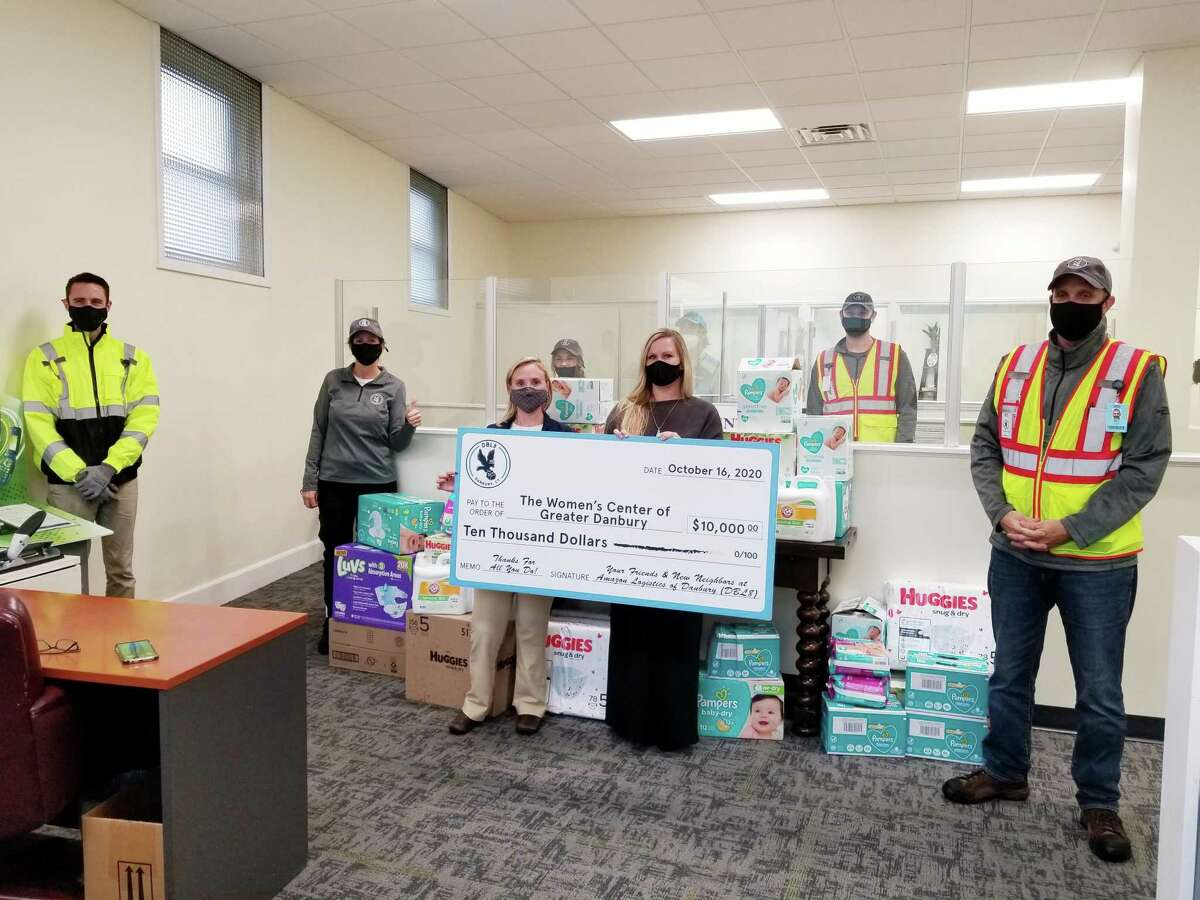 Women's Center Development Director Samantha Flynn and Lynn Nichols, director of Victim Services, recently accepted a monetary donation, along with a truck load of diapers in all sizes, delivered by several members of the team from the new Amazon Delivery Station in Danbury.