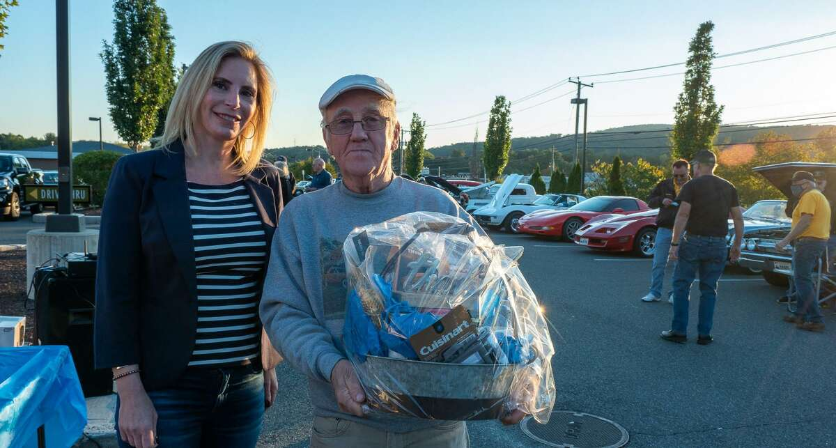 Kristen Gizzi, executive director of Litchfield Crossings, with New Milford's Bob Scribner, grand prize winner of Cruise Nights raffle.