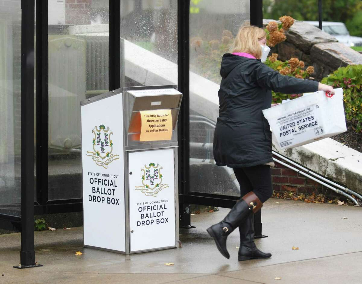 Ballots are picked up from the offical drop outside Town Hall in Greenwich, Conn. Wednesday, Oct. 28, 2020.