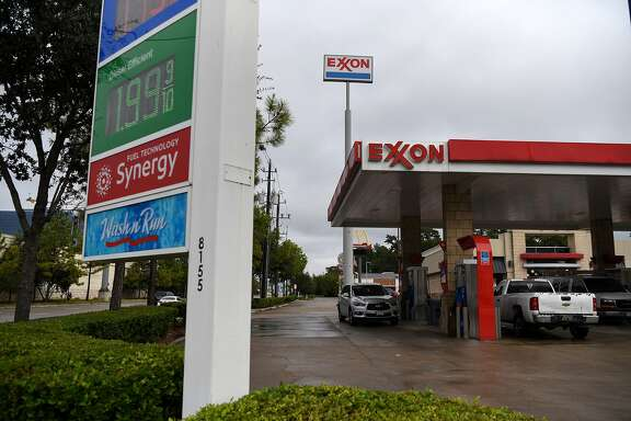 Vehicles refuel at an Exxon Mobil Corp. gas station in Houston, Texas, U.S., on Wednesday, Oct. 28, 2020. Exxon is scheduled to release earnings figures on October 30. Photographer: Callaghan O'Hare/Bloomberg