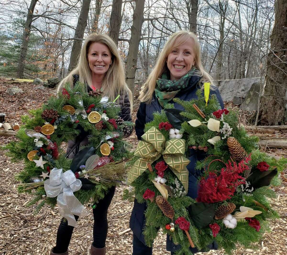 Two happy participants at Woodcock Nature Center's Wreath Festival last year.