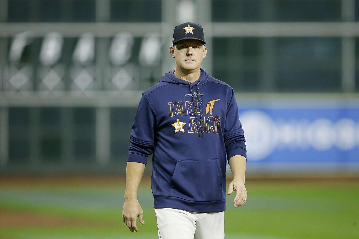AJ Hinch #14 of the Houston Astros looks on during batting practice prior to Game Seven of the 2019 World Series against the Washington Nationals at Minute Maid Park on Oct. 30, 2019 in Houston, Texas. The Detroit Tigers have signed HInch to a 3-year contract as manager. (Bob Levey/Getty Images/TNS)