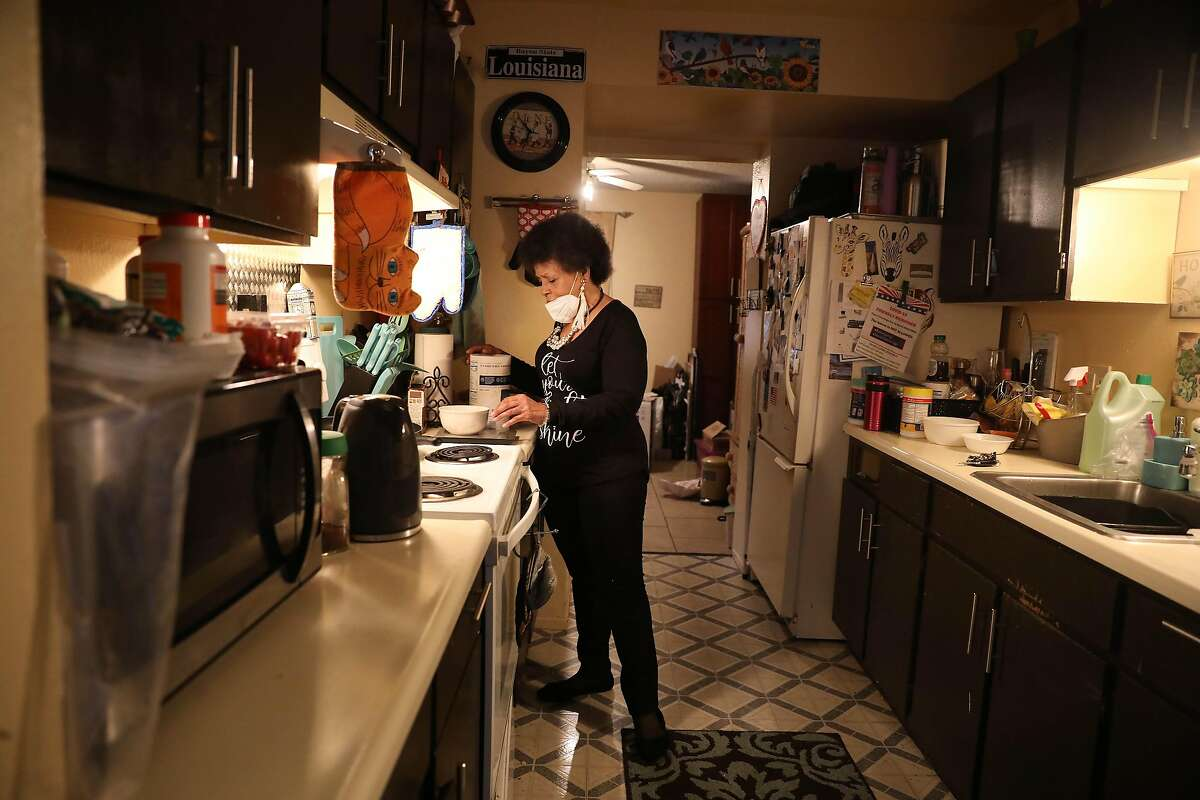 Mattie Scott makes herself breakfast in her kitchen.