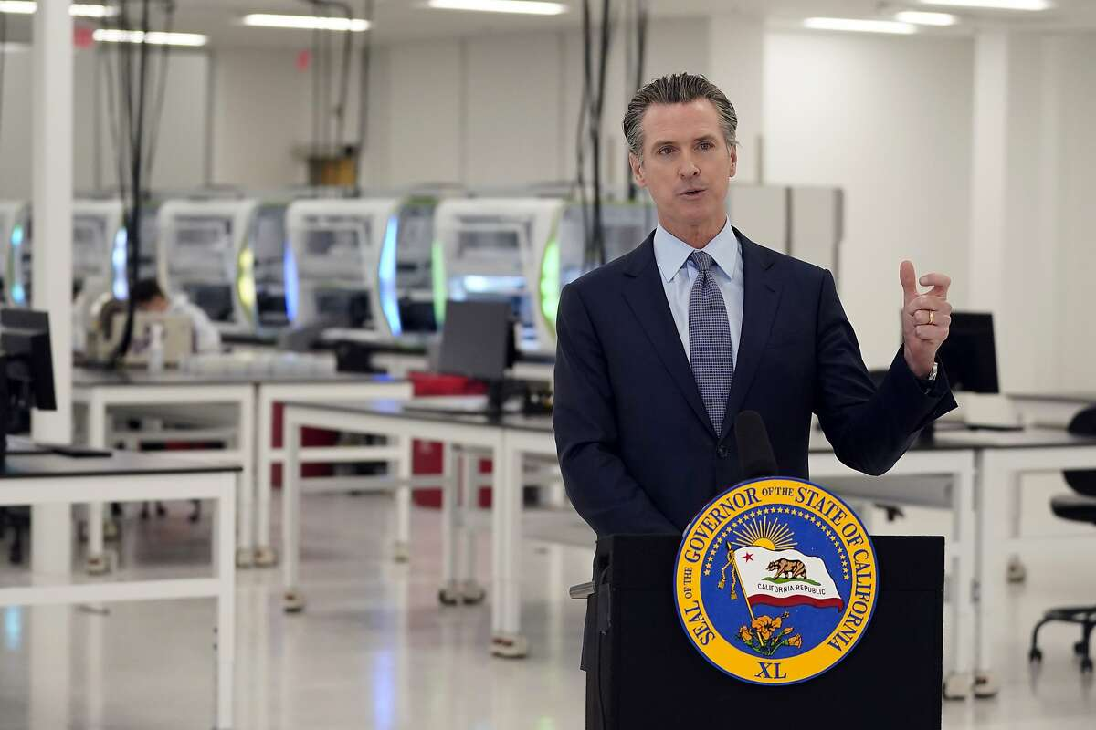 California Gov. Gavin Newsom speaks at a COVID-19 testing facility Friday, Oct. 30, 2020, in Valencia, Calif.