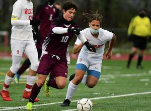 Greenville's James Mitchell, left, battles with Maple Hill's Tyler Shaw during the Patroon Conference boys' soccer title game on Friday,  Oct. 30, 2020 in Craryville, N.Y. Mitchell scored the only goal of the game. (Lori Van Buren/Times Union)