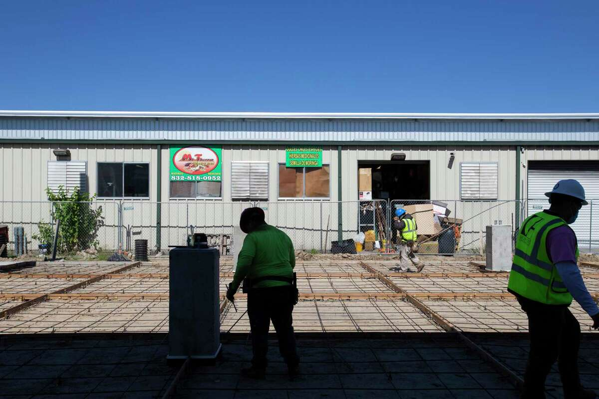 Construction workers working on the open air market section of the Houston Farmers Market, which is being redeveloped, Friday, Oct. 30, 2020, in Houston.
