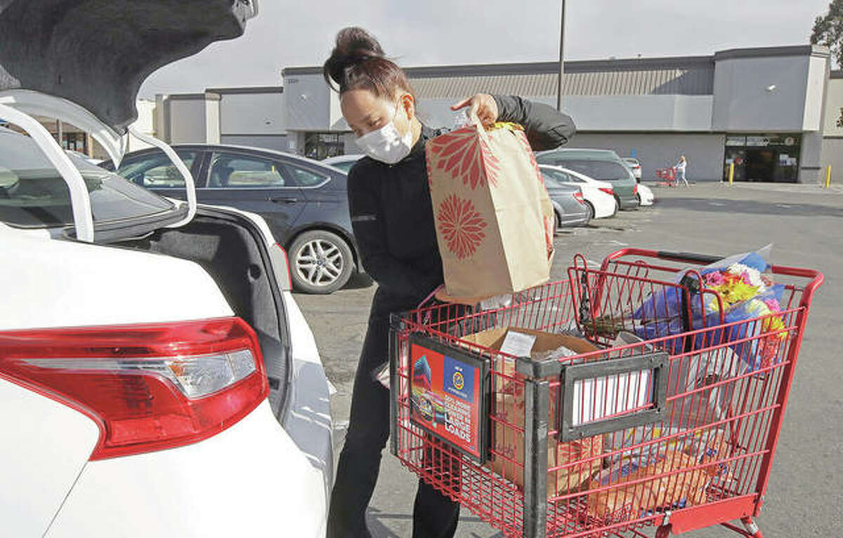 Instacart worker Saori Okawa loads groceries into her car for home delivery. There are plenty of jobs in the gig work arena. To stay safe and find the right fit, evaluate the risks, expand your search beyond the obvious roles and calculate how much you'll really make after taking expenses such as fees and insurance into account.