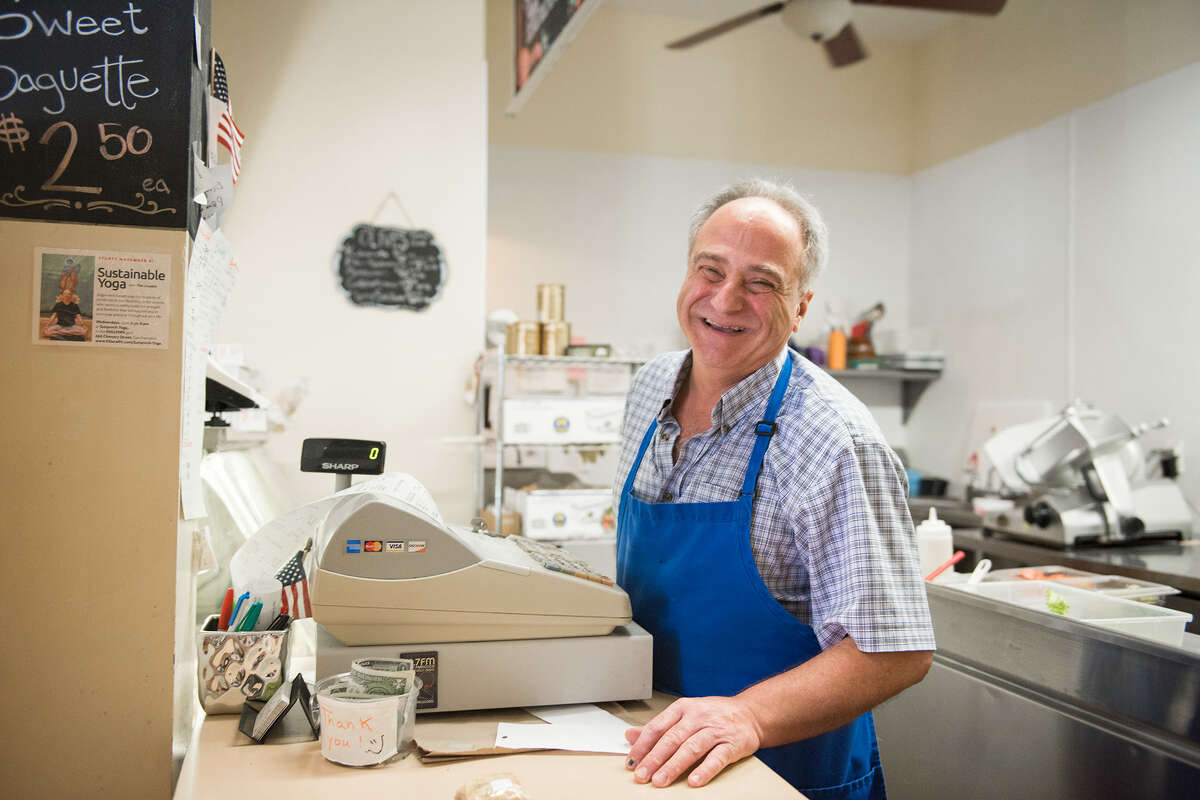Cheese Boutique owner Rachid Malouf behind the counter of the shop.